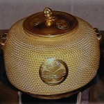 antique gold water vessel used for tea ceremony